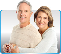 senior couple smiling with dental implants